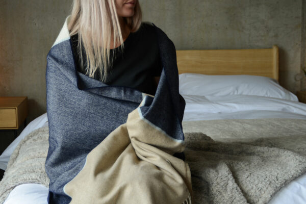 beige and blue throw