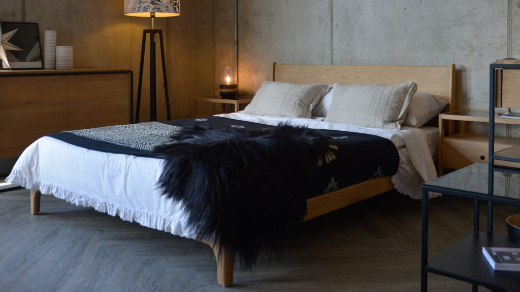 Monochrome bedding gives our hand made wooden Carnaby Bed a Scandi look.