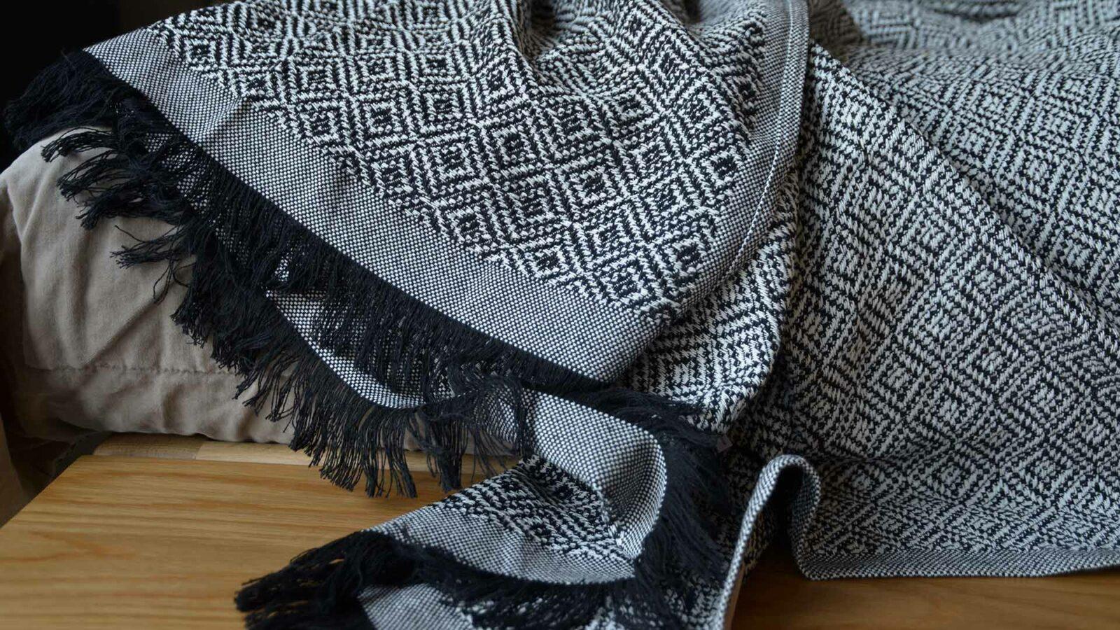 cotton rich woven design black and white throw