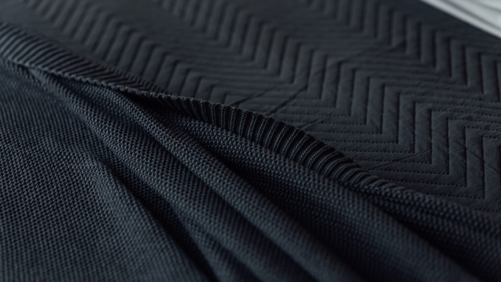 black bedding - chevron bedspread and knitted throw