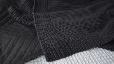 Black knitted throw from Natural Bed Company