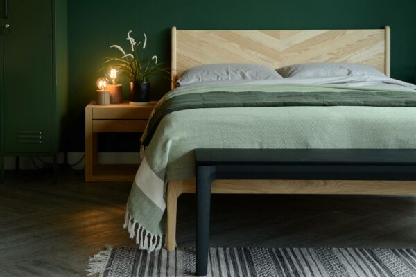 black painted solid oak bench or end of bed table shown in a bedroom