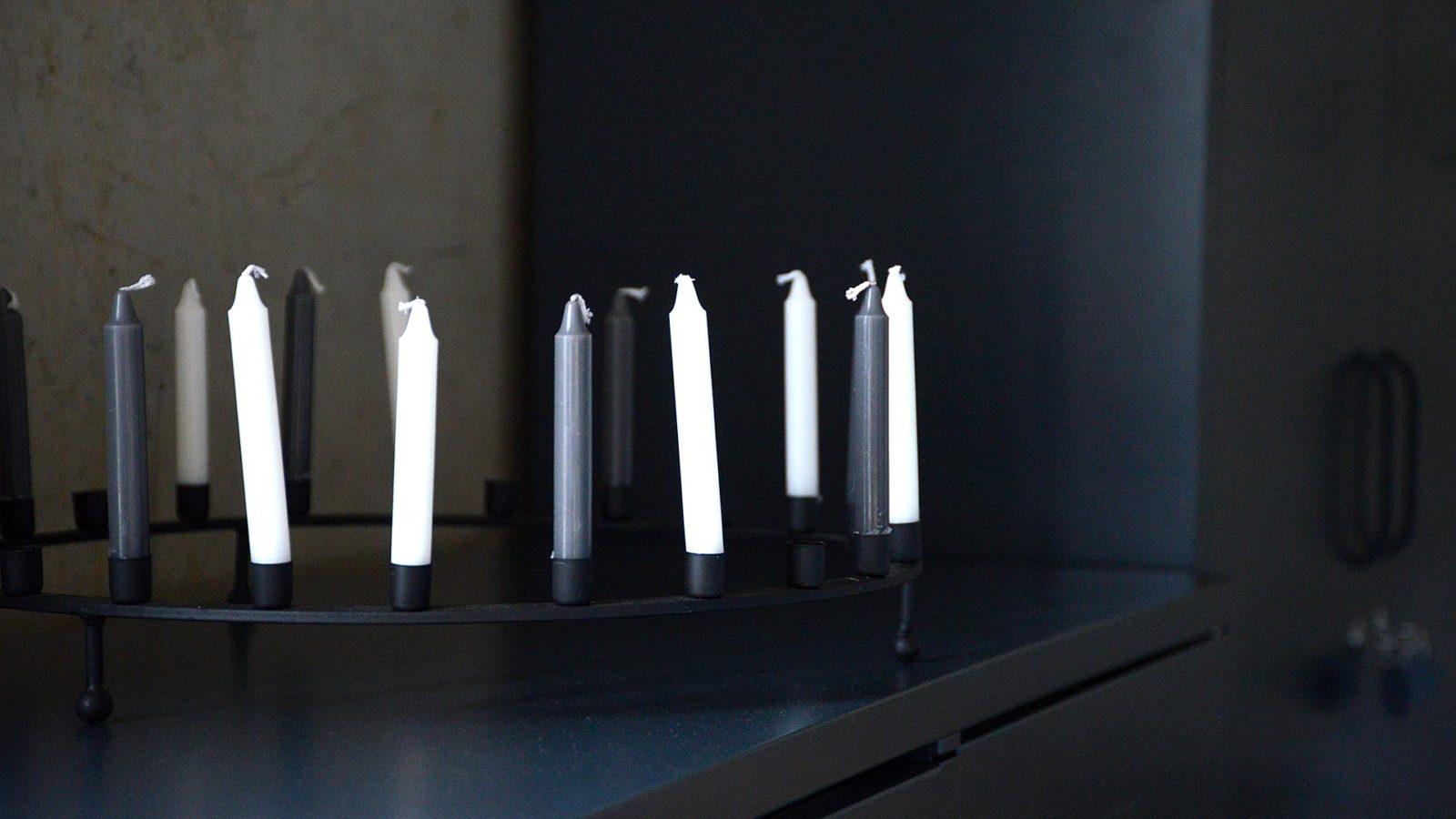 black ring shaped candle holder