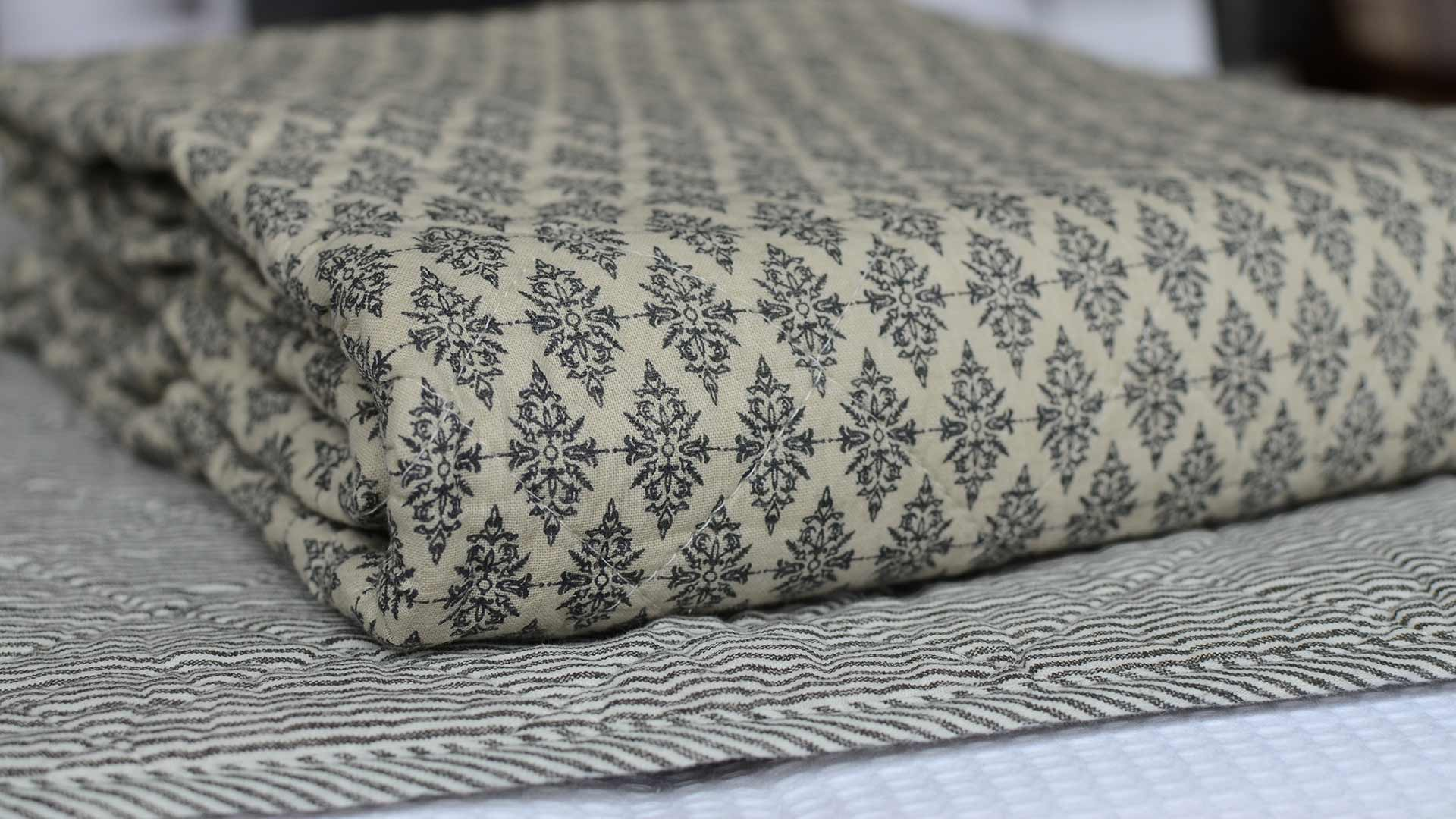 black-diamond-quilted-throw-on-striped-throw