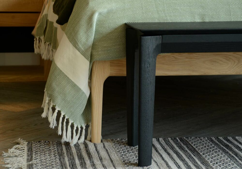 black painted solid oak bench or end of bed table a detail view