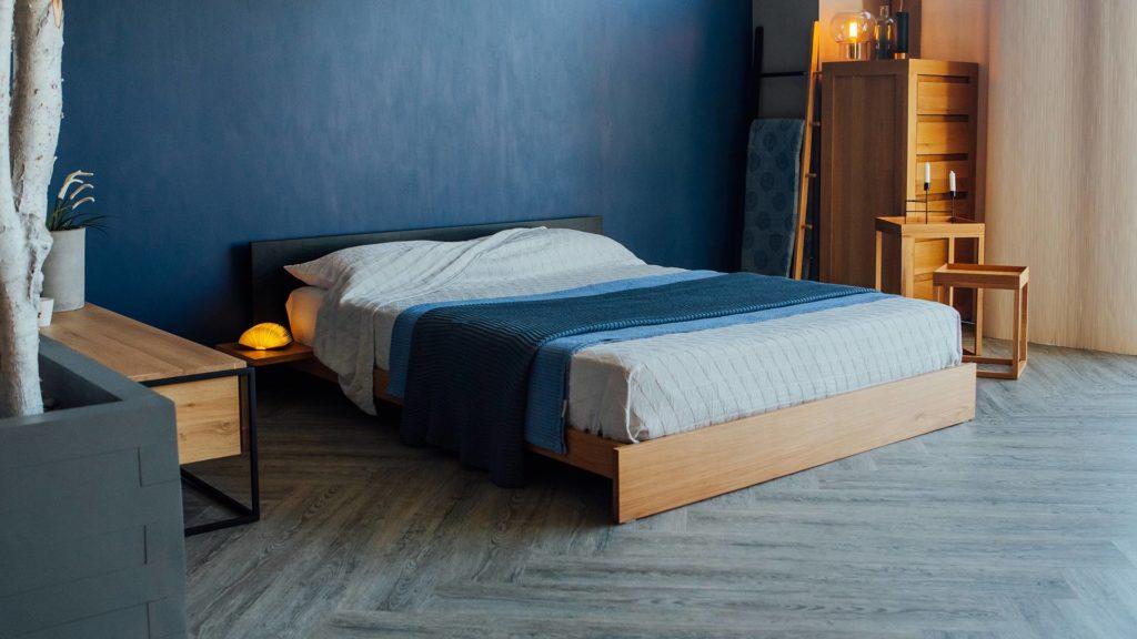 Our Oak Kulu low platform bed has a contrasting black-painted headboard.