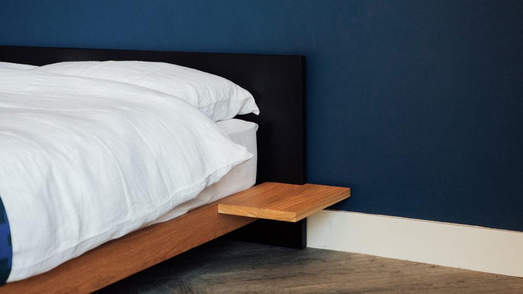 Black Oak Kulu Platform Bed with contrasting Oak side rails and floating Side Tables