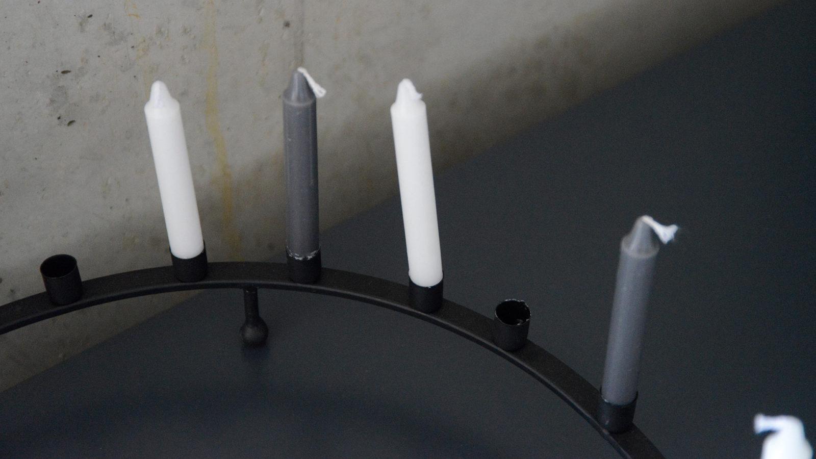 circular black metal candle holder