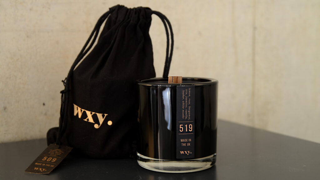 woodwick scented candle in sophisticated black glass jar with gift bag