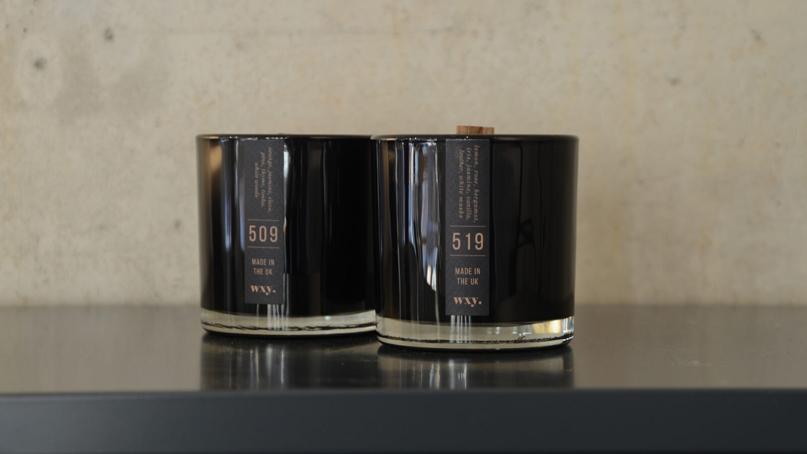 Black wax woodwick scented candles in sophisticated black glass jars