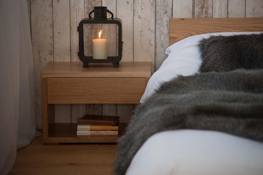 Rustic look bedroom using our low cube bedside table in Oak