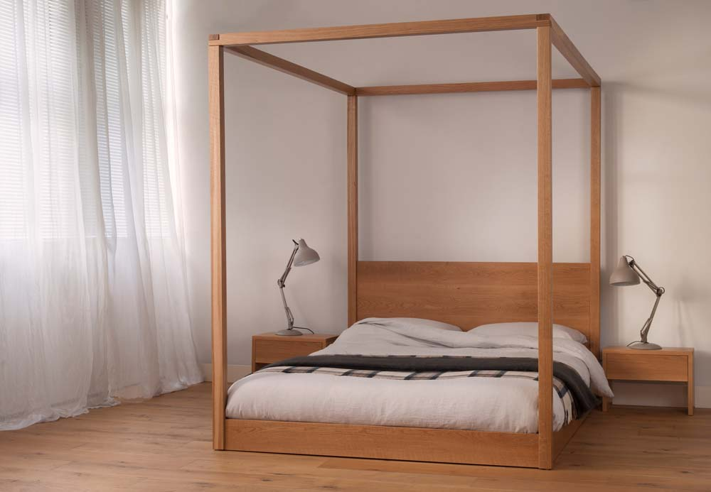 The Cube Bed a modern four poster bed available to order in a range of sizes and timbers.