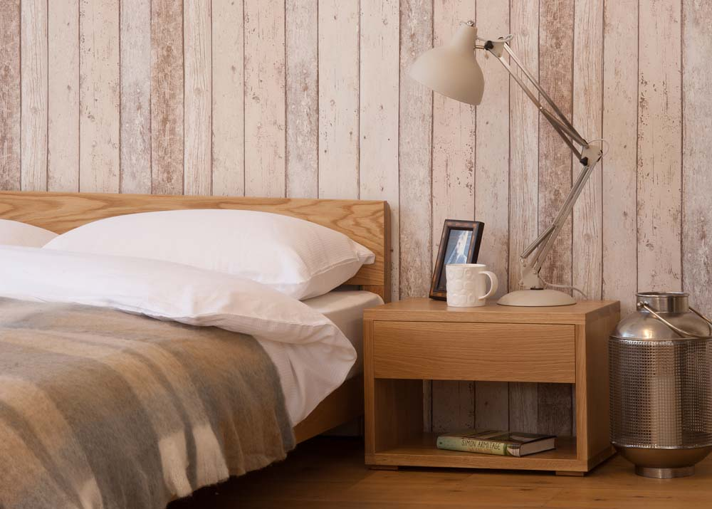 A Rustic bedroom look featuring our low wooden Nevada bed made from Oak