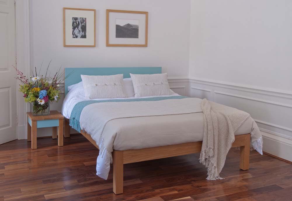 guest bedroom styles - Tao wooden bed frame with a colourful painted headboard