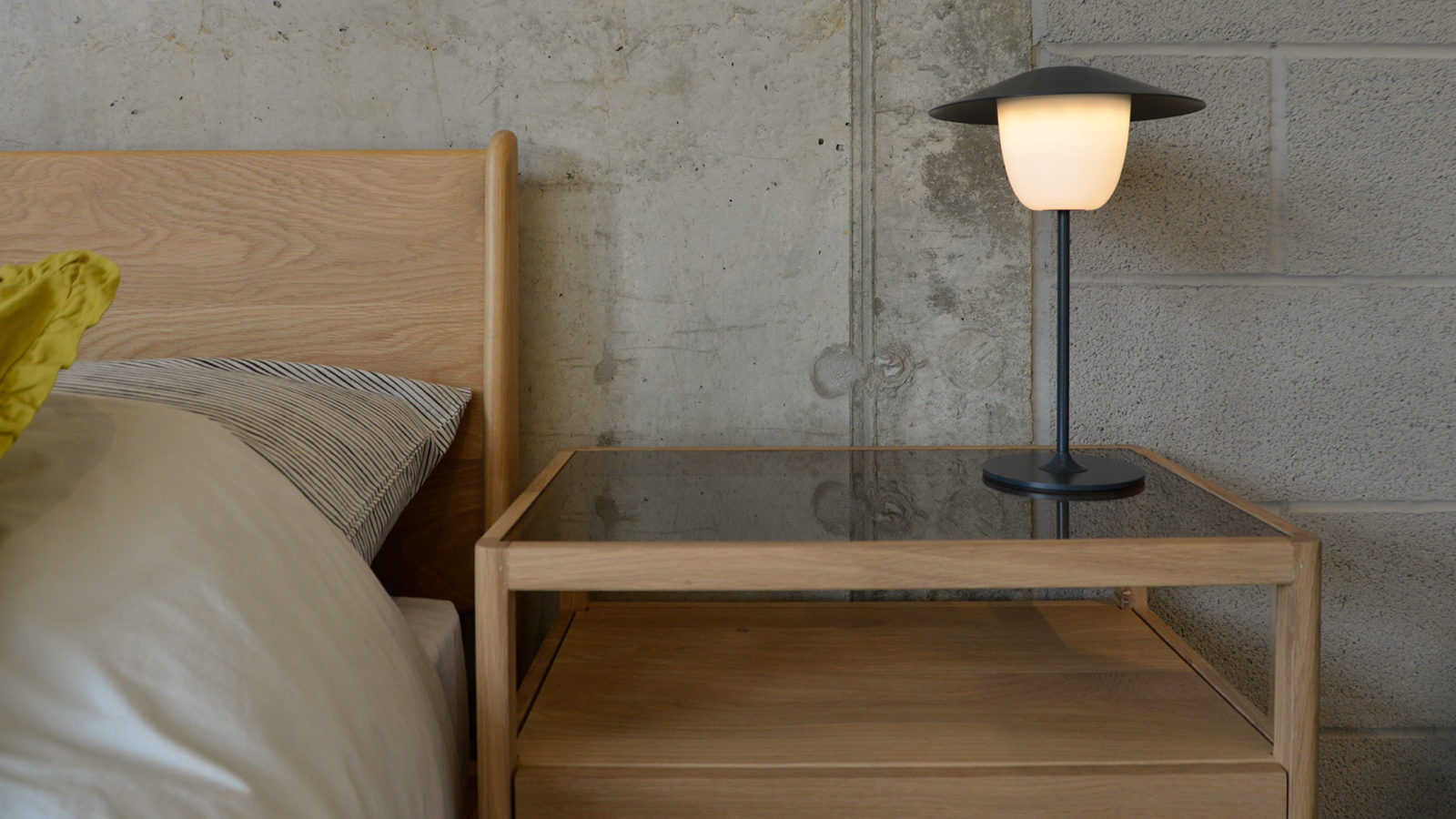 Blomus Rechargeable Lamp - on a Spindle Bedside Table in solid oak