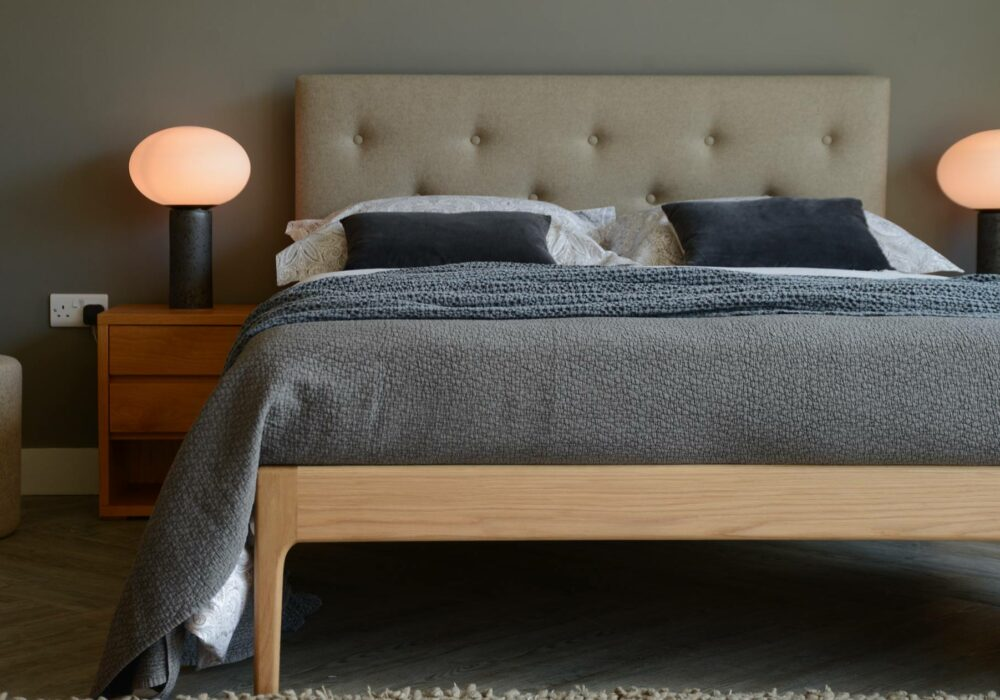 Mid-century style wooden bed with upholstered headboard