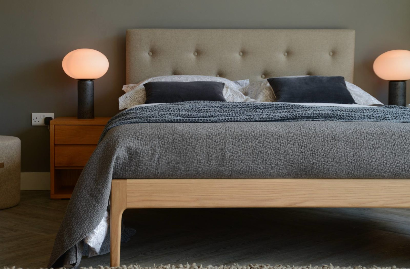 Mid-century style bed with upholstered headboard