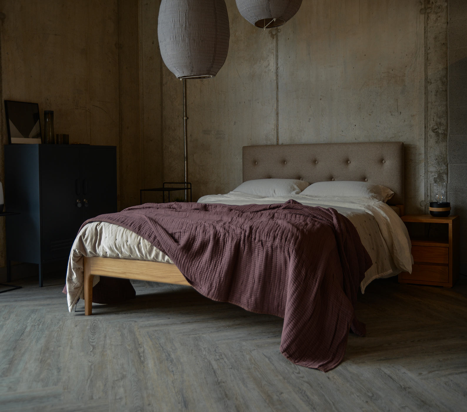 Hand made Bloomsbury bed in oak with a wool upholstered headboard.