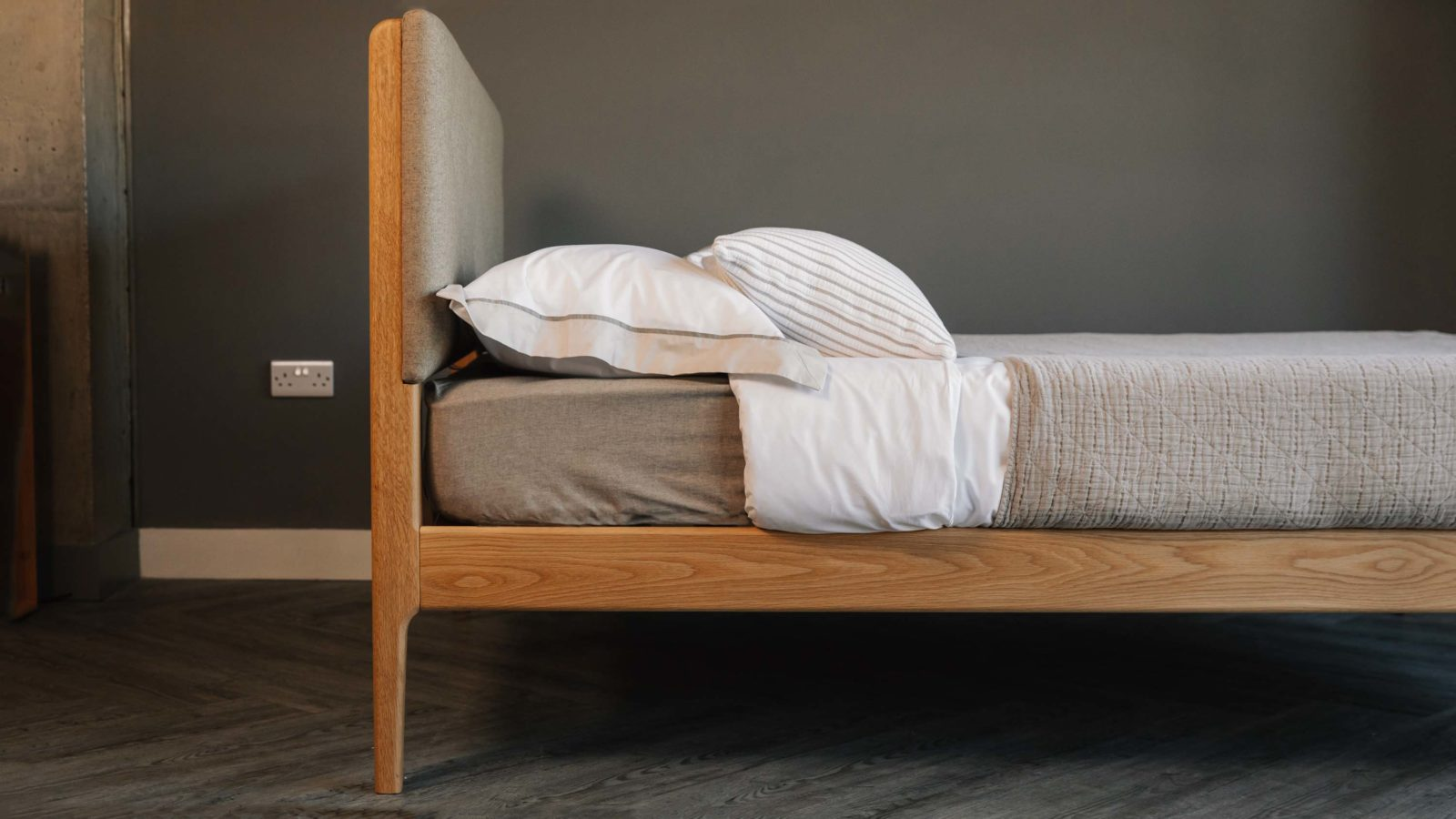 Side view showing the Upholstered Bloomsbury bed Headboard and Oak frame