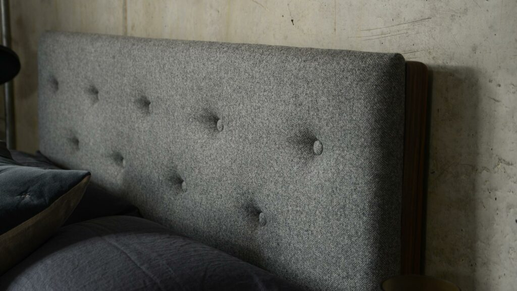 A closer view of the buttoned upholstered Bloomsbury bed headboard