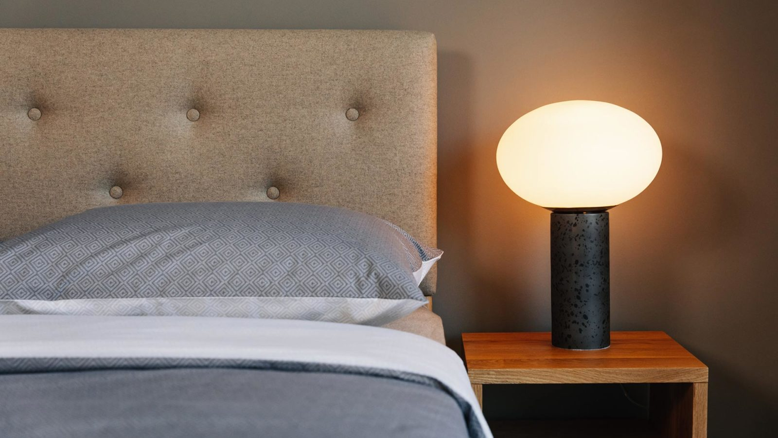 The Bloomsbury bed buttoned and upholstered headboard, available in a choice of wool fabrics