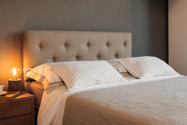 cosy wool upholstered padded and buttoned headboard