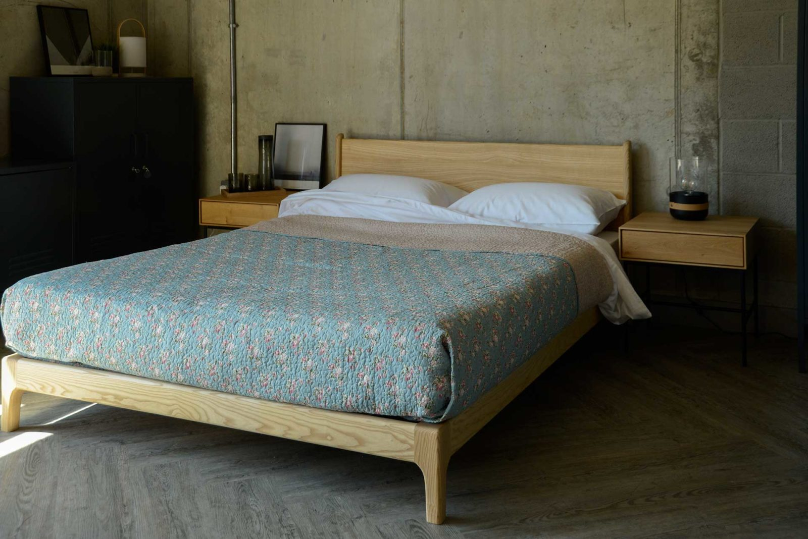 Vintage look pale blue patterned bedspread on solid wood Carnaby bed