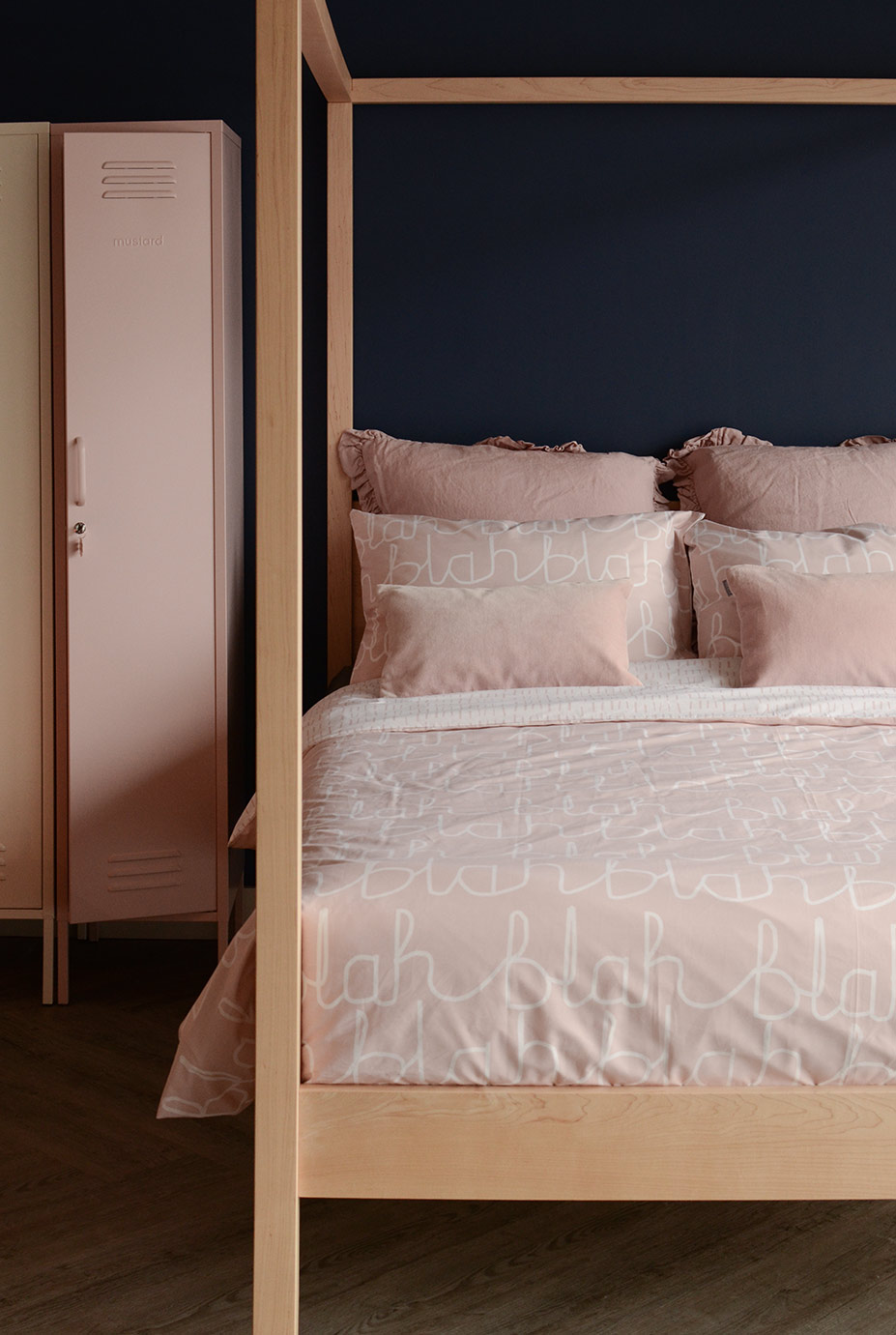Our Orchid 4 poster wooden bed shown with blush pink bedding