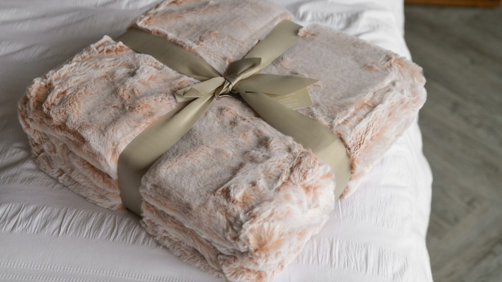 Soft and snuggly Faux fur throw in frosted blush pink