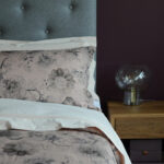 blush printed linen blend bedding on Skye wooden bed with padded headboard
