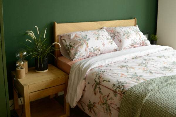 blush pink and green decor - palm print bedding on an Oak Hoxton bed