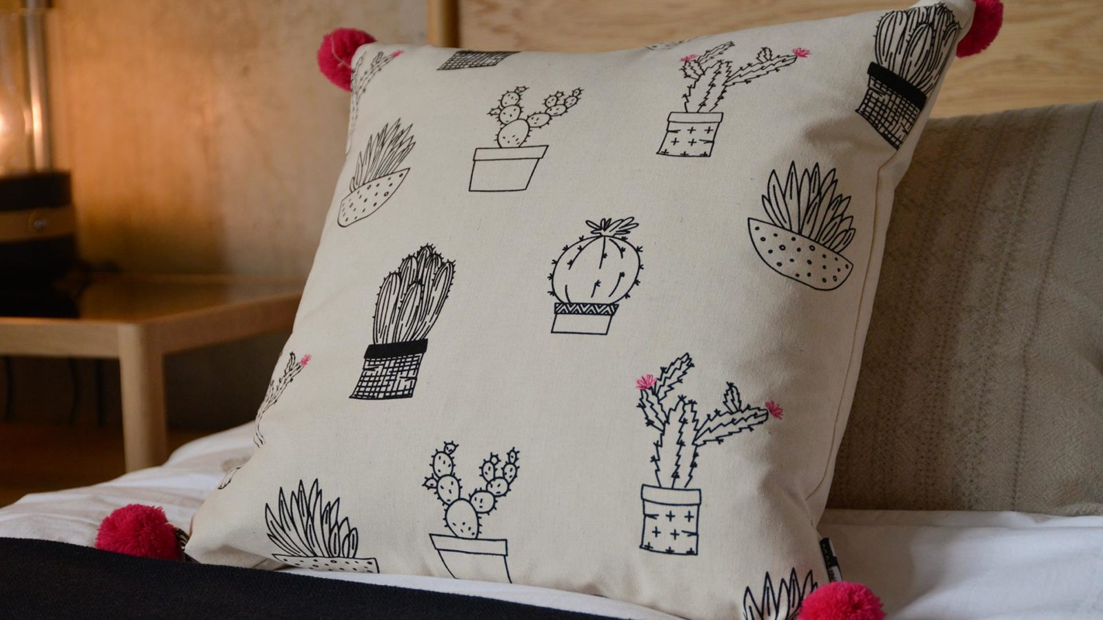 cactus-print-cushion-with-pompoms