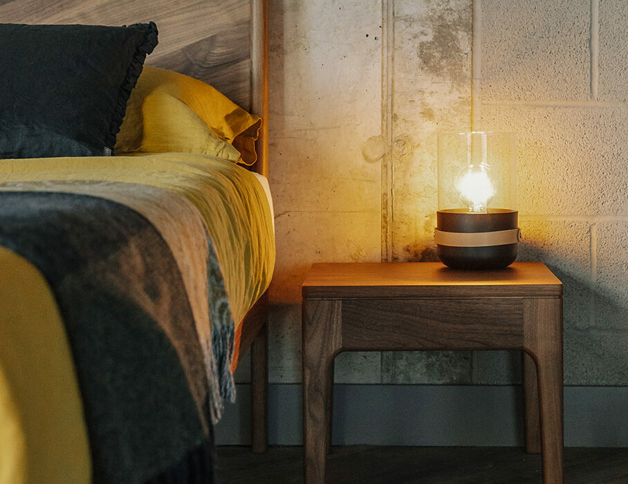 Camden solid wooden table shown with our Walnut Hoxton bed