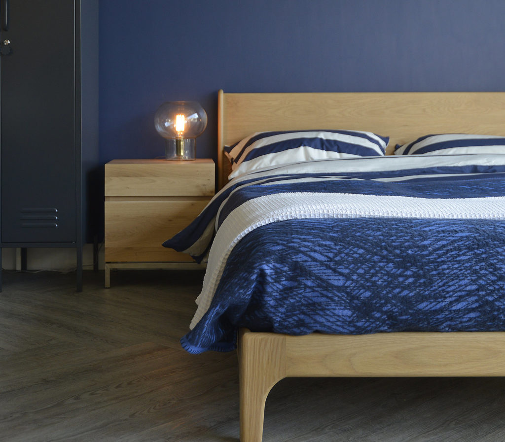 A closer view of the low wooden Carnaby bed which comes in a choice of wood and a range of sizes.