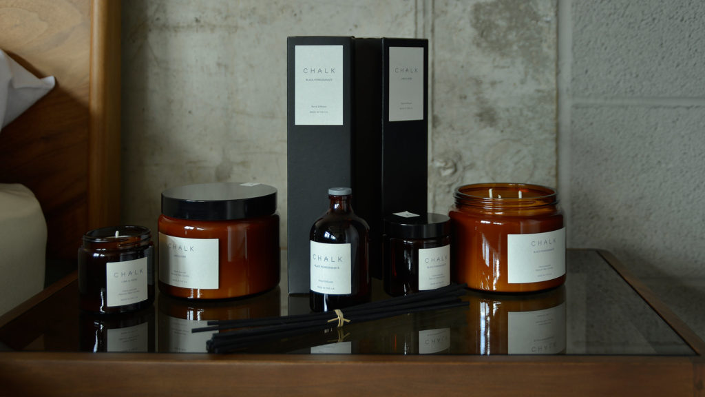 scented candles and diffusers in amber glass jars