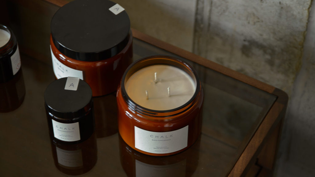 scented candles in amber coloured jars