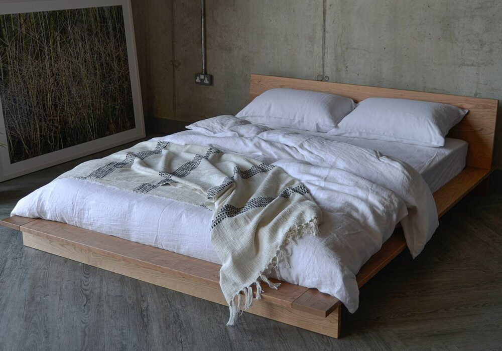 white linen bedding on the low platform style Oregon beds made from solid cherry wood