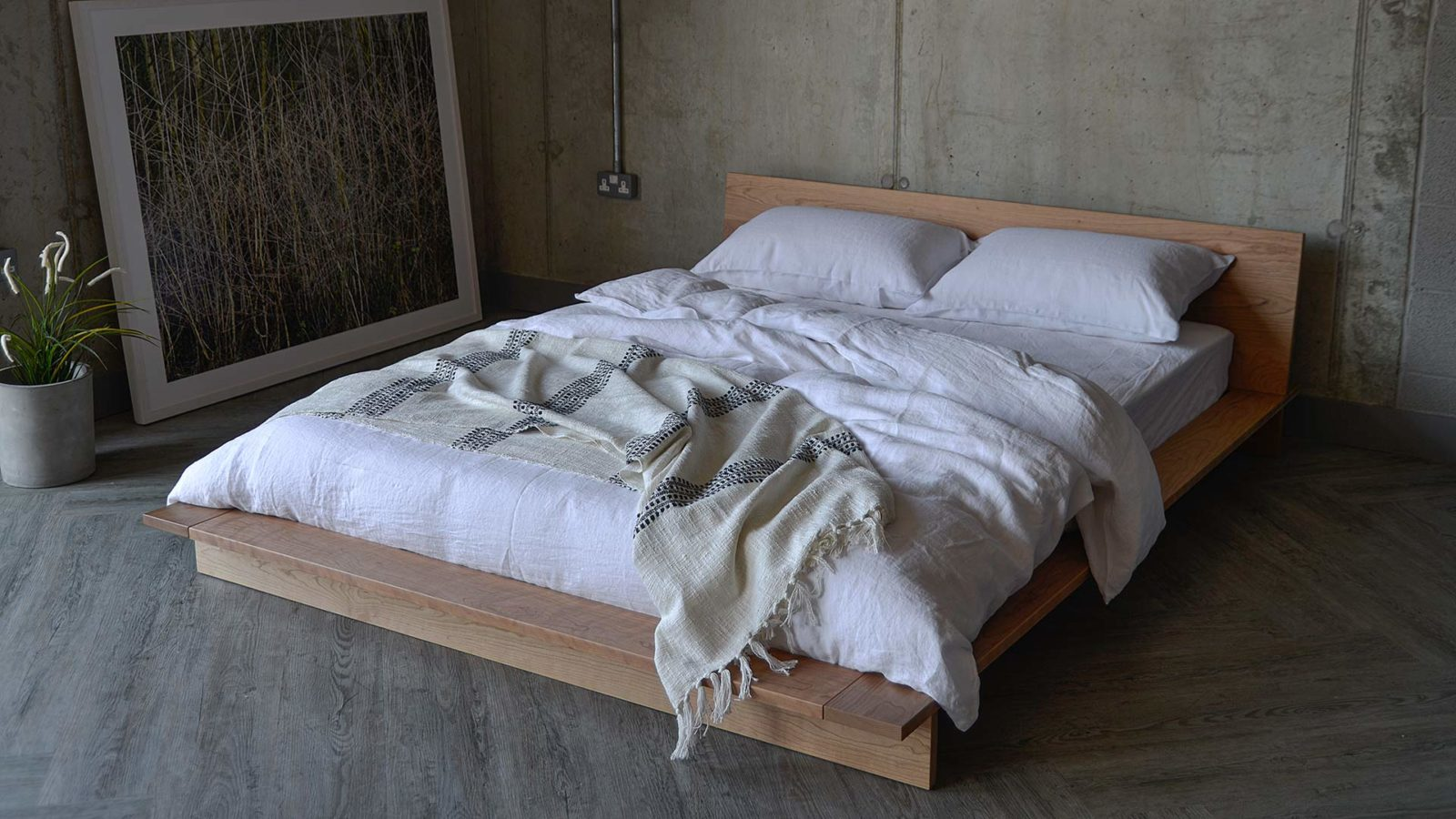 white linen bedding on the low platform style Oregon bed made from solid cherry wood