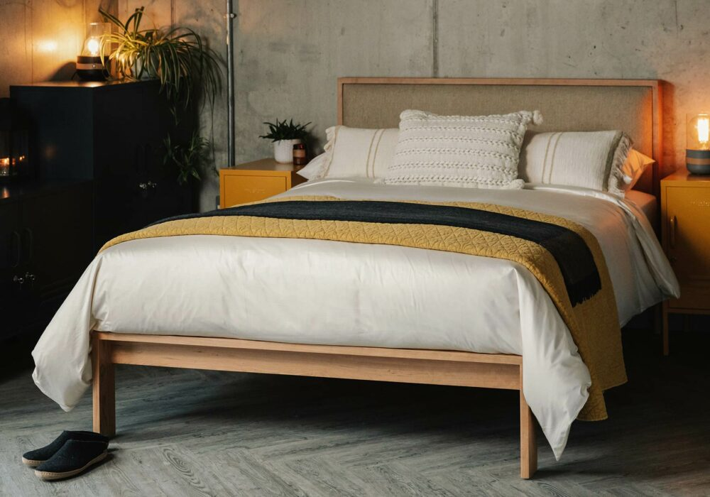 Shetland solid wooden bed in cherry with cream organic cotton bedding
