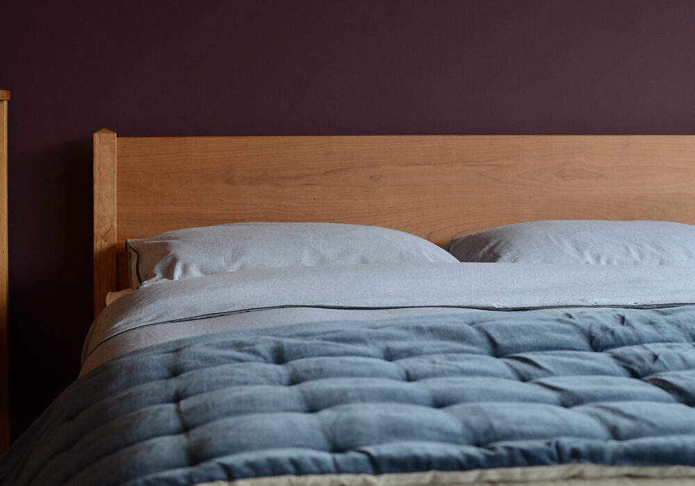 A closer view of the Cochin Classic wooden bed headboard in Cherry