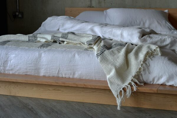 open weave cotton throw in ivory and black