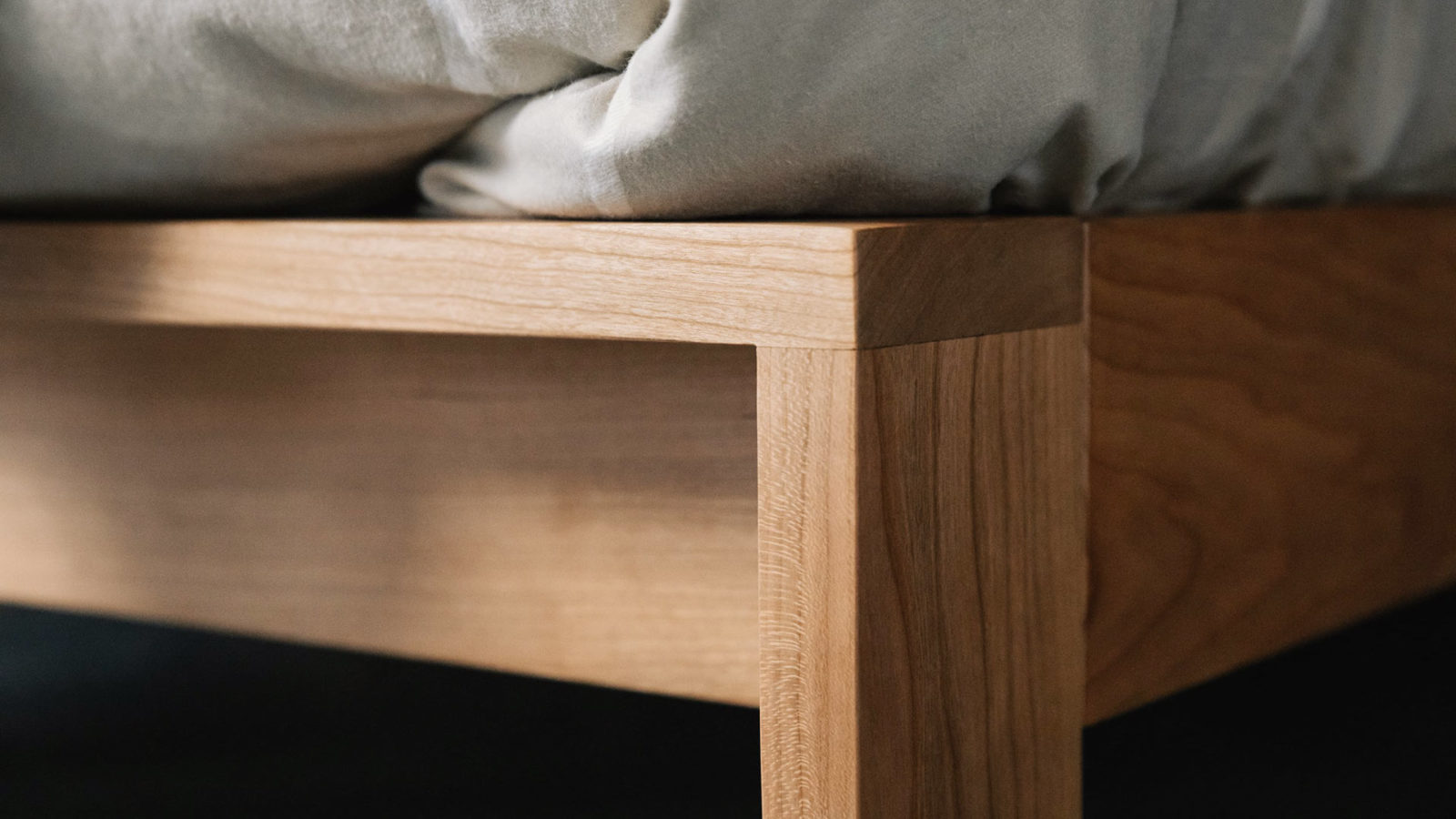 Shetland is a solid wood bed frame with an upholstered headboard, this is a close view of the leg joint detail