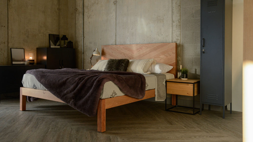 the Hathersage contemporary solid wood bed with chevron pattern headboard in cherry for an industrial look