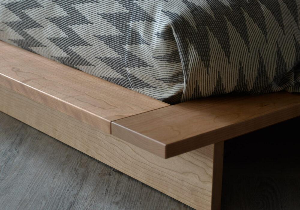 Oregon wooden platform bed in cherry - foot end - corner detail photo