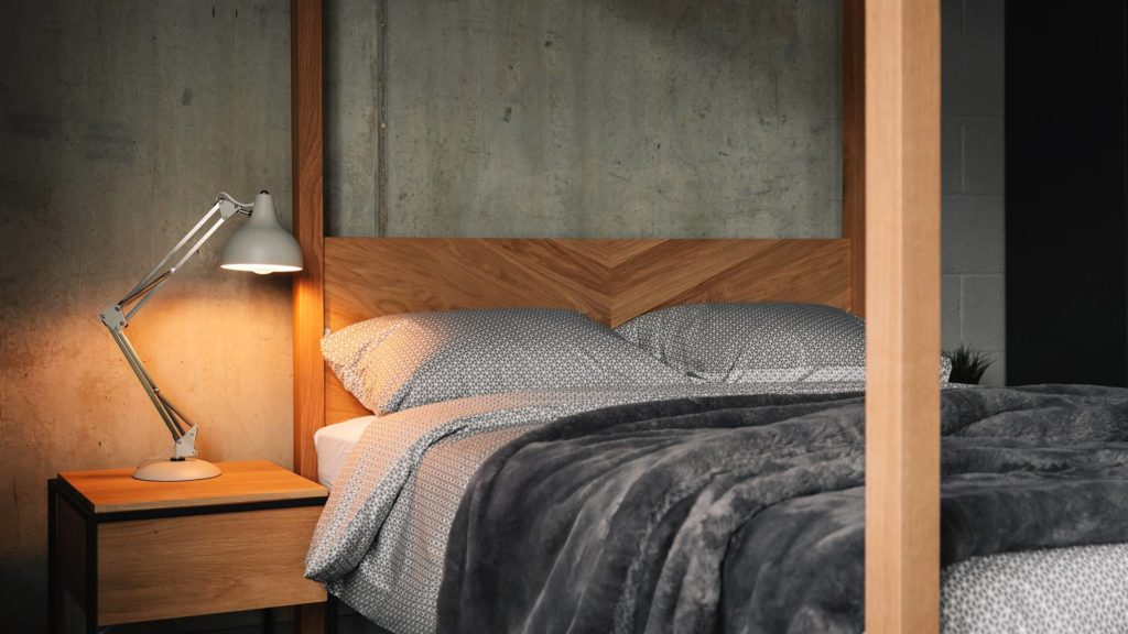 Grey cotton bedding on the contemporary solid wood Kelham 4 poster bed with parquet headboard
