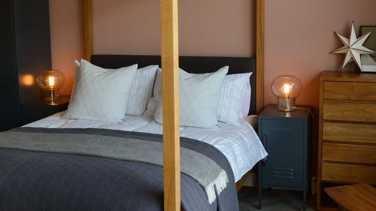 Ikat Stripe printed duvet set and deep grey bedding on our solid wood Highland 4 poster bed