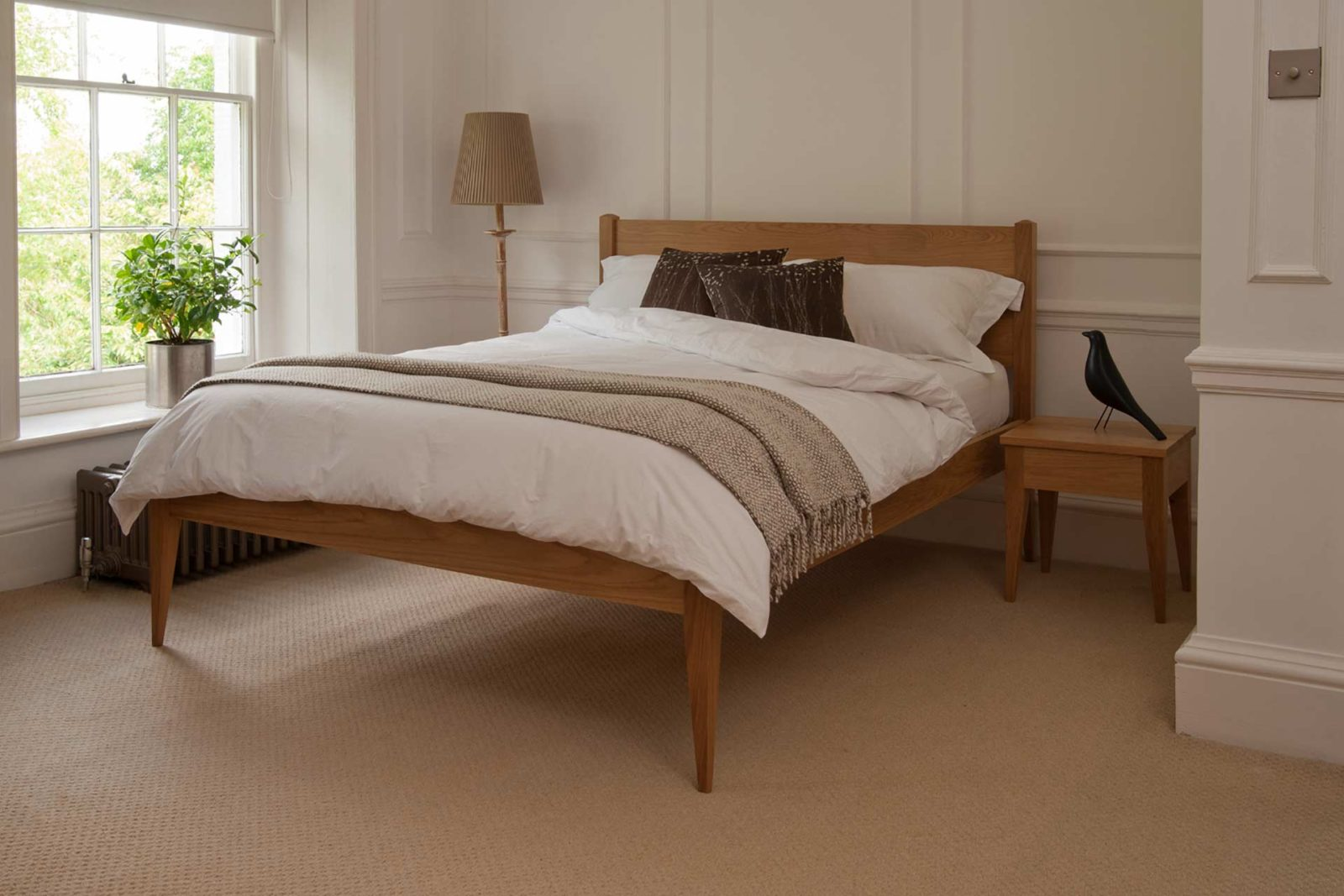 A Classic taller wooden Bed, The Cochin is available to order in a choice of timbers and bed sizes
