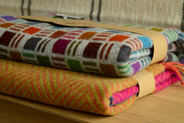 bold colours merino wool throws shown stacked