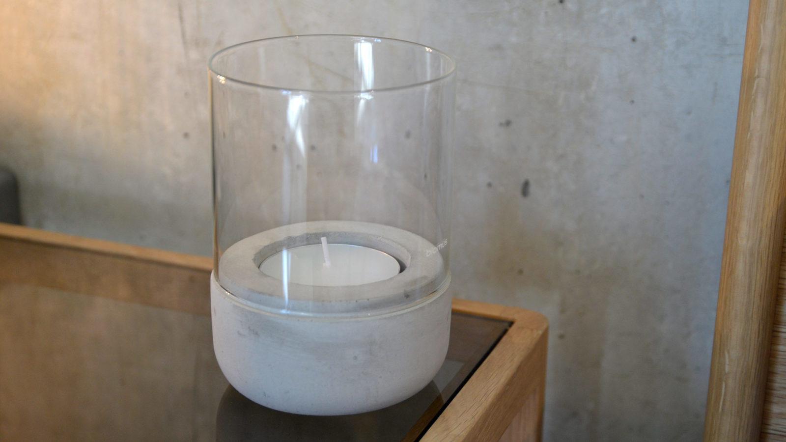 concrete-and-glass-candle-holder-on-bedside