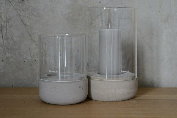 minimalist hurricane lanterns with concrete bases